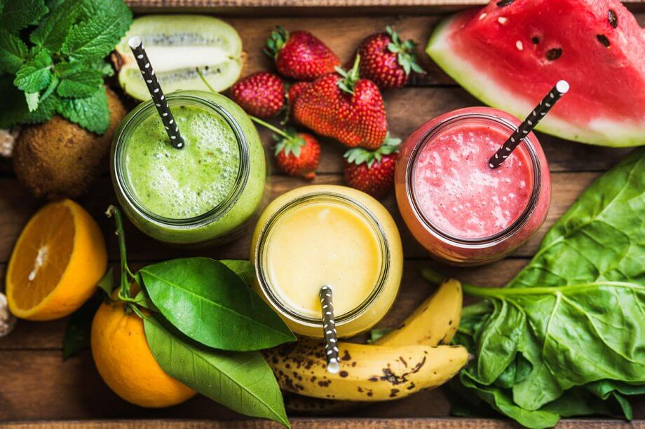 tray of fresh fruit and smoothies
